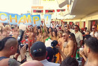 McGregor laps up the poolside pandemonium as hundreds of fans cram in to welcome him. Photo / YouTube - The MacLife.