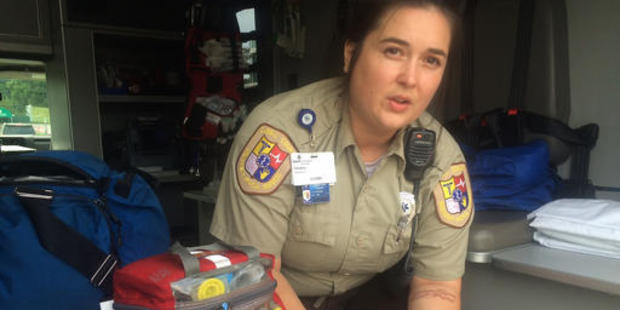 Cabell County emergency responder Tabitha Perez demonstrates how medics administer naloxone to overdosing patients in Huntington. Photo / AP