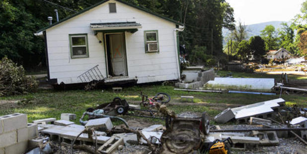 The Phillips family home sits several metres away from its broken foundation at the end of Mill Hill Drive in White Sulphur Springs, West Virginia. Photo / AP