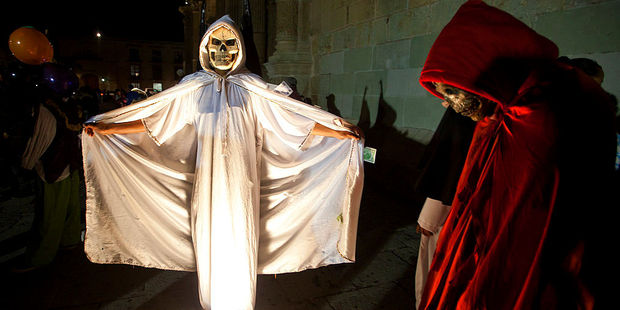 People in ghoulish costumes participate in a parade for the Day of the Dead in Oaxaca. Photo / Getty Images