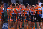 Knights players look dejected after conceding a try to the Tigers in the NRL yesterday. Photo / Getty Images
