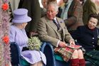Queen Elizabeth II ,Prince Charles and Princess Anne at the 2016 Braemar Highland Gathering. Photo / Getty Images