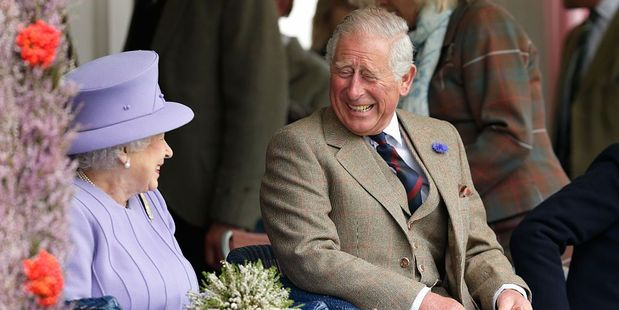 Prince Charles wore a lavender flower in his button-hole to match the Queen's outfit. Photo / Getty Images