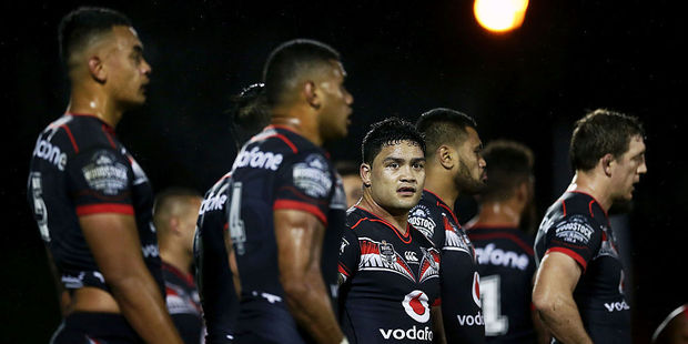 Dejected Warriors players after conceding another try. Photo / Getty