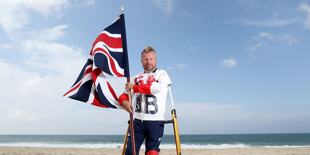 Equestrian rider Lee Pearson of Great Britain poses for a photo on the beach after being chosen as Great Britain's flagbearer for the Paralympic Games. Photo / Getty Images
