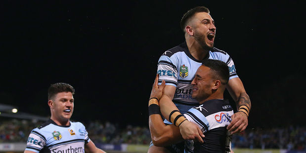 Chad Townsend of the Sharks watches on as Jack Bird and Valentine Holmes celebrate Holmes scoring a try. Photo / Getty