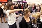 L-R: Kathryn Farnworth, The Good Place, Ahuriri, Napier, $15 hairdo for Jessica Clark, Havelock North - Women's Lifestyle Expo at Pettigrew.Green Arena, Taradale, Napier, run by NZME Events.