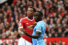 Manchester United's Anthony Martial (left) clashes with Manchester City's Bacary Sagna when the two sides met last season at Old Trafford. Photo / Photosport