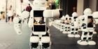 Watch: Robots queue for iPhones