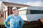 A woman living in a caravan on a friend's lawn has been forced to move out because she breached city rules by staying there for more than three months in a year.