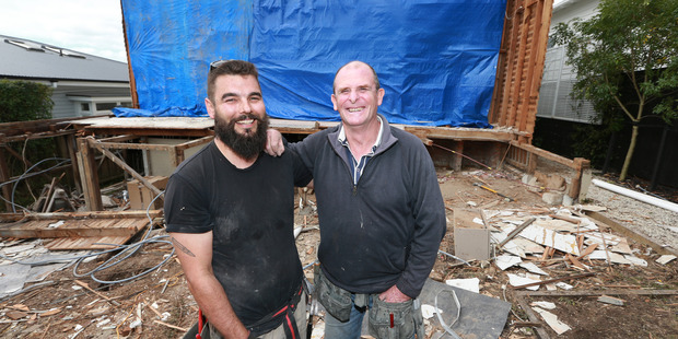 Carl Watson, left, and boss Gary Freshwater on their building site at Westmere yesterday. Freshwater took a tongue-in-cheek approach to find some decent staff and found Watson. Photo / Doug Sherring