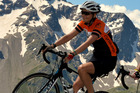 Kirstin back up on her bike, cycling on the Col du Galabier in the French Alps in 2014.