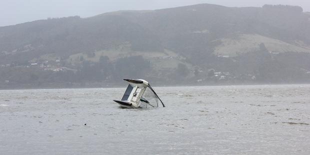 Loading A Moored Catamaran opposite the beach at Macandrew Bay in Dunedin. Photo / Hayden Wilson