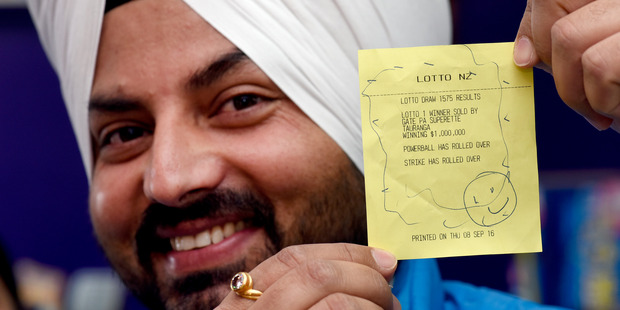 Loading Gate Pa Superette owner Ravinder Singh-Cheema holding the $1m Lotto first division ticket confirmation slip. Photo/George Novak.