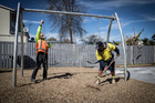 Workman install new swings at Delphine Reserve. Photo / Michael Craig