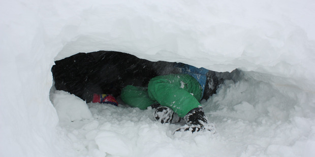 The students enjoyed digging tunnels in the snow. Photo / Supplied
