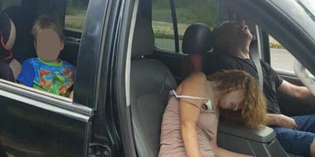 Ohio police have released a graphic photo of a couple overdosing on heroin with a 4-year-old boy in the car. Photo / East Liverpool Police department