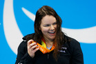 New Zealand's Mary Fisher celebrates with her gold medal during the Womens 100m Backstroke S11 in Rio. Photo / www.photosport.nz