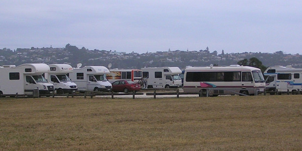 Freedom campers line the foreshore at Westshore Beach.