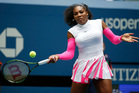 Serena Williams, of the United States, returns a shot to Johanna Larsson, of Sweden, during the third round of the U.S. Open. Photo / AP.
