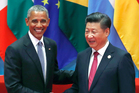 U.S. President Barack Obama, left, shakes hands with China's President Xi Jinping. Photo / AP
