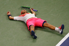Lucas Pouille, of France, reacts after beating Rafael Nadal, of Spain, during the fourth round of the U.S. Open tennis tournament. Photo / AP.