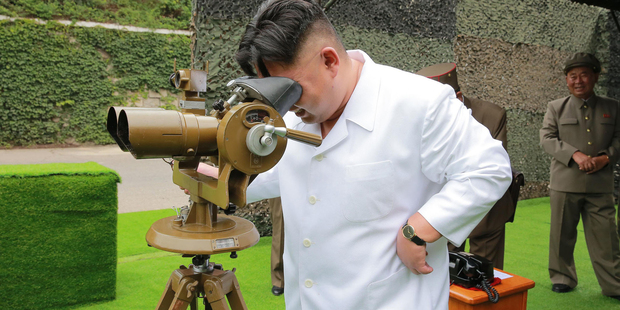 North Korean leader Kim Jong Un looks through binoculars at the site of a ballistic missile launching earlier this month.