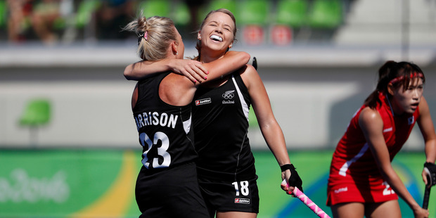 New Zealand's Kirsten Pearce, center, celebrates with teammate New Zealand's Charlotte Harrison after scoring against South Korea. Photo / AP.