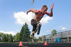 In this Monday, Aug. 1, 2016, photo, paralympian runner A.J. Digby takes off in a full sprint during a workout at the Eastwood High School track in Pemberville, Ohio. Photo / AP.