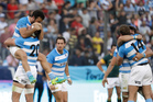 Argentina's Los Pumas players celebrate after defeating South Africa 26-24. Photo / AP