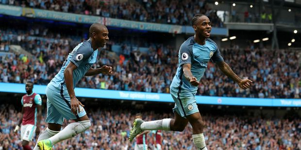 Manchester City's Raheem Sterling, right, celebrates with team-mate Fernandinho. Photo / AP.