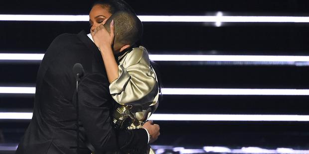 Rihanna embraces Drake as she accepts the Video Vanguard Award at the MTV VMAs. Photo / AP