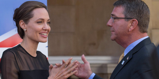 Angelina Jolie with US Defence Secretary Ash Carter at a UN Peacekeeping Defence Ministerial meeting, in London. Photo / AP