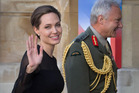 UN Special Envoy Angelina Jolie is greeted by UK Vice Chief of the Defence Staff General Sir Gordon Messenger in London. Photo / AP