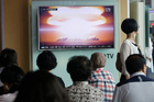 People watch a TV news program reporting North Korea's nuclear test at Seoul Railway Station in Seoul. Photo / AP
