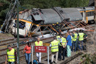 Emergency personnel attend the scene after a passenger train derailed in Spain. Photo / AP