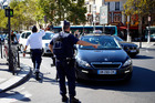 Police officers divert traffic away from the Gare de Lyon railway station in Paris, France, during a bomb scare. Photo / AP