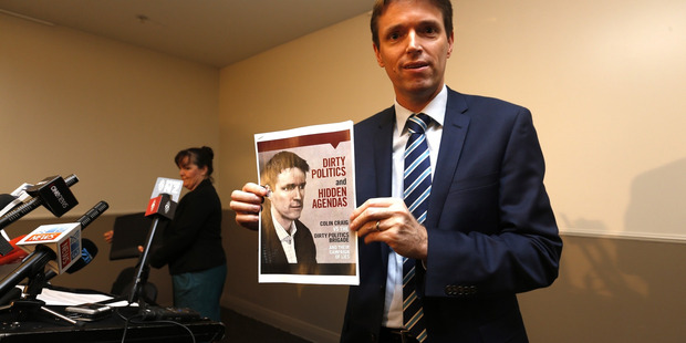 Colin Craig holds the booklet in which he allegedly defamed Tax Payers Union executive director Jordan Williams. Photo/Dean Purcell NZ Herald