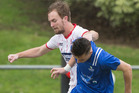 Birkenhead United's James Lawson and Napier City Rovers Angus Kilkolly during the semifinal of the Chatham Cup. Photo / Greg Bowker