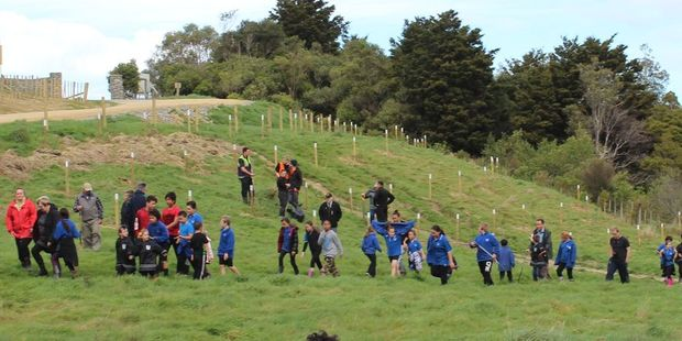 Children from  Woodville School at Ferry Reserve after completing the planting of 81 rata trees in memory of the town's WW1 fallen soldiers.