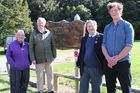 A Dannevirke World War I committee project, the poppy places of remembrance was celebrated at Norsewood's Anzac Park. Kathryn Mulinder (left) secretary of the Dannevirke and Districts RSA, Roly Ellis, president of the RSA, Tim Delaney, chairman of the World War I committee, and Alex Lewis, who carried out the project. Photo / Christine McKay