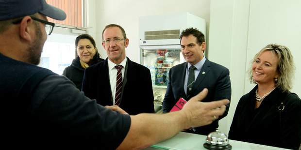 Ikaroa Rawhiti Labour MP Meka Whaitiri (left), Labour Party leader Andrew Little, Napier Labour MP Stuart Nash and Labour candidate for Tukituki Anna Lorck talk to Paul Greaney of The Village Butcher (back to camera), Havelock North during Little's visit to Hawke's Bay. Photo / Warren Buckland