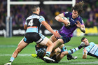 Kevin Proctor of the Storm is tackled during the round 26 NRL match between the Melbourne Storm and the Cronulla Sharks. Photo / Getty Images.