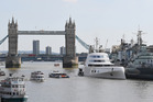 A Russian billionaire's Philippe Starck-designed boat is seen moored next to HMS Belfast on the River Thames.