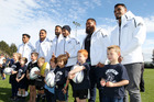All Blacks Malakai Fekitoa (left), Ofa Tu'ungafasi, Patrick Tuipulotu, George Moala, Charlie Faumuina and Jerome Kaino pose with the Eskview club 5th graders, as part of the All Blacks to the Nation, at Petane Domain yesterday. Photo / Duncan Brown