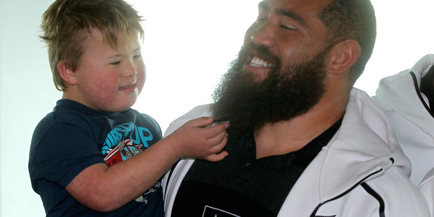 HE DA MAN: Five-year-old David Richardson, of Clive, up close and personal with All Blacks prop Charlie Faumuina at Hawke's Bay Airport yesterday. PHOTO/Duncan Brown