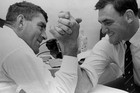 Sir Colin Meads and Sir Brian Lochore arm-wrestle in 1968. Photo / NZH Archives Supplied by The Sun, Australia.
