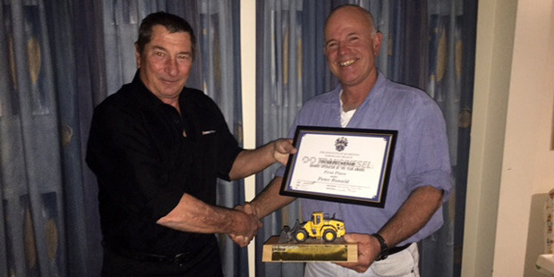 Peter Ronald (right) accepting his award as the Quarry Operator of the Year from Craig Ormrod (Transdiesel).