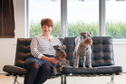 Travel Wags founder Sarah Hall and her pet dogs Billy and Archie.