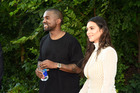 Kanye West and Kim Kardashian were all smiles at the Kanye West Yeezy Season 4 fashion show, but the event was panned by guests and fashionistas. Photo / Getty